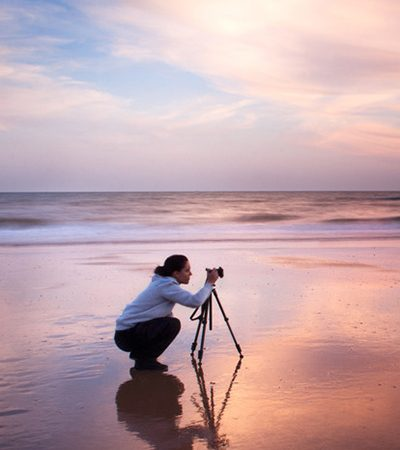Photographer with tripod shooting a landscape in Doñana